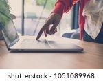 young start up woman wearing... | Shutterstock . vector #1051089968