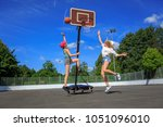 two teenage girls playing... | Shutterstock . vector #1051096010