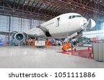 passenger airplane on... | Shutterstock . vector #1051111886