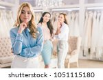 thoughtful blonde bride and... | Shutterstock . vector #1051115180
