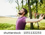 young man extending arms and... | Shutterstock . vector #1051132253