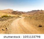 desert road crater arif... | Shutterstock . vector #1051133798