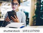 pensive young businesswoman ... | Shutterstock . vector #1051137050