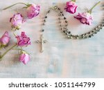 rosary on a painted pastel... | Shutterstock . vector #1051144799