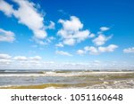 blue sky with clouds over a sea.   Shutterstock . vector #1051160648