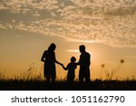 family on sunset background.... | Shutterstock . vector #1051162790