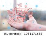 shopping concept above a hand... | Shutterstock . vector #1051171658