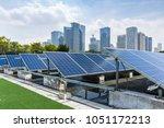 solar and modern city skyline | Shutterstock . vector #1051172213