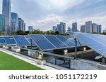 solar and modern city skyline | Shutterstock . vector #1051172219