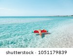 woman on lilo in the sea water. ... | Shutterstock . vector #1051179839