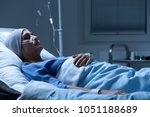 ill  old woman suffering from... | Shutterstock . vector #1051188689