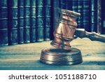Small photo of Auctioneers Or Judges Gavel Or Hammer On The Wooden Judge Or Auctioneer Table. Law, Auction Bidding, Judicial Practice Or Judicial Hearing Concept, Close Up. Front View. Different Effects