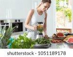 smiling vegan woman making a... | Shutterstock . vector #1051189178