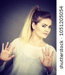 Small photo of Woman having disgust face expression seeing unpleasant thing deny something showing stop gesture with open hands, grey background.