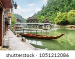 parked wooden tourist boat on... | Shutterstock . vector #1051212086