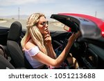 young blonde woman riding red... | Shutterstock . vector #1051213688