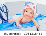 Stock photo cute baby girl in a sun hat laying on a beach lounge chair 1051216466