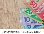 canadian dollar on wooden table ... | Shutterstock . vector #1051221380