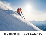 skier rides freeride on powder... | Shutterstock . vector #1051222460