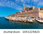 valletta skyline with fortress... | Shutterstock . vector #1051225823