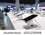 smartphones on the background... | Shutterstock . vector #1051250048