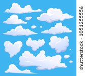 cartoon clouds isolated on blue ... | Shutterstock .eps vector #1051255556