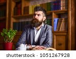 rich man with thoughtful face.... | Shutterstock . vector #1051267928