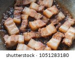 pan fried five spiced pork... | Shutterstock . vector #1051283180