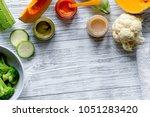 baby vegetable puree on wooden... | Shutterstock . vector #1051283420
