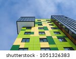 colored facade wall of a modern ... | Shutterstock . vector #1051326383