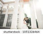 lovely happy wedding couple ... | Shutterstock . vector #1051326464