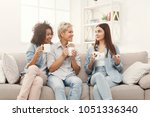 diverse female friends at home. ... | Shutterstock . vector #1051336340