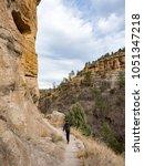 boy walking on trail at gila... | Shutterstock . vector #1051347218