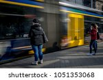passengers at the tram stop.... | Shutterstock . vector #1051353068
