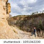man pondering cliffs at ancient ... | Shutterstock . vector #1051362230