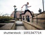 freerunner is jumping between...   Shutterstock . vector #1051367714