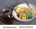 chinese noodles with egg ... | Shutterstock . vector #1051378250