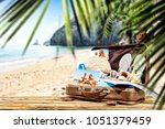 suitcase on desk and free space ... | Shutterstock . vector #1051379459