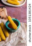 Small photo of Mozzarella sticks coated with hot sauce. Aperitif to accompany meals