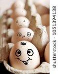 photo of fresh eggs in vertical ... | Shutterstock . vector #1051394138