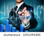 businessman touching in graph | Shutterstock . vector #1051394300