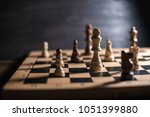 chess on chessboard close up | Shutterstock . vector #1051399880