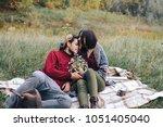 the guy gave the girl flowers | Shutterstock . vector #1051405040