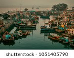 fishing boats at dockyard ... | Shutterstock . vector #1051405790