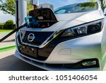 Small photo of Pearland, Texas - March 21, 2018: New 2018 Nissan Leaf electric car plugged in to charge battery at the EVgo charging station
