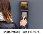 woman pushing the button and... | Shutterstock . vector #1051414076