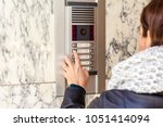 woman pushing the button and... | Shutterstock . vector #1051414094
