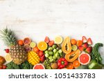 fruits and vegetables rich in... | Shutterstock . vector #1051433783