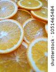 Small photo of Orange, half of orange, orange lobule , orange background