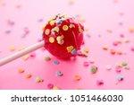 pink round lollipop close up on ... | Shutterstock . vector #1051466030